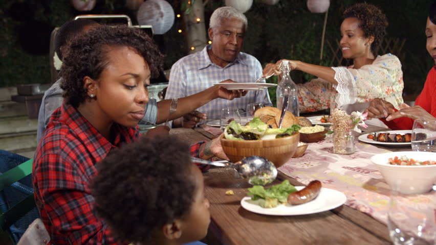 Multi Generation Black Family Serving Food At Table Outdoors Stock Footage Video 23190079