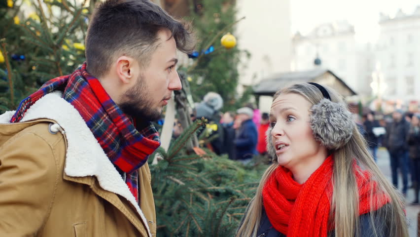 Worried couple standing on the square and chatting with each other, steadycam shot  | Shutterstock HD Video #23252239
