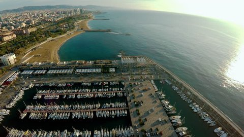 Aerial view. Berth yacht and boats off the coast of Barcelona. Spain. ProRes. Shot in 4K (ultra-high definition (UHD)).
