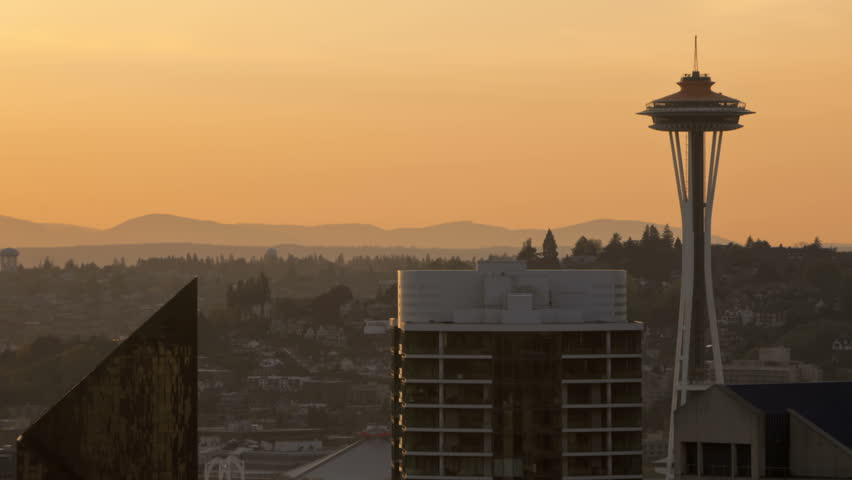 Timelapse of Seattle Space Needle during sunset. Space Needle in new orange