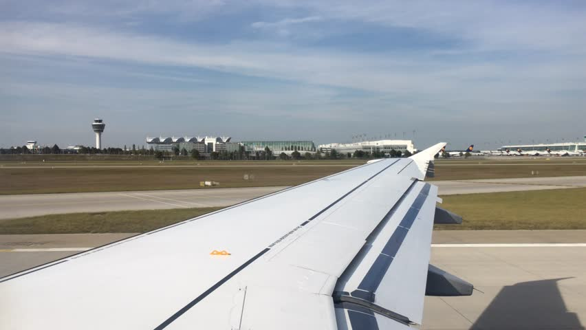 Germany, Munich, 1 October 2016: The plane moves on the airport of Munich to a runway, Lufthansa passes parking of planes, it is a lot of other planes on parking | Shutterstock HD Video #23296039