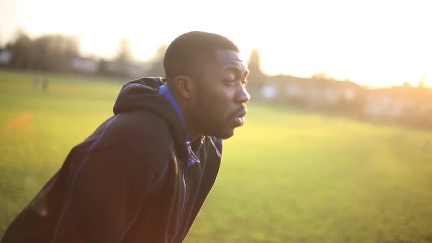 Exhausted Athlete at Sunset