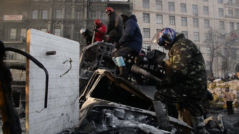 Kiev, Ukraine, January 2014: Protesters on the barricades near the government quarter at the time of the protests against President Yanukovych's policies. Street Grushevskogo, 26 January 2014