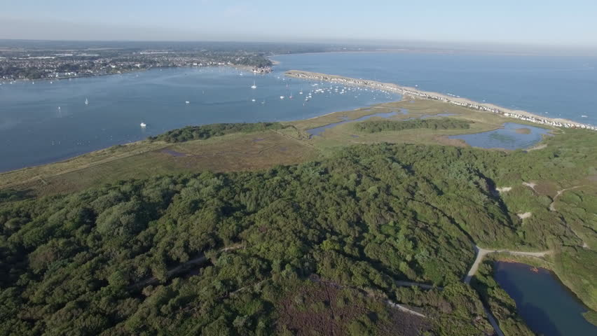 Aerial Footage Of Beach Near Bournemouth On The South Coast United Kingdom Looking Over Towards