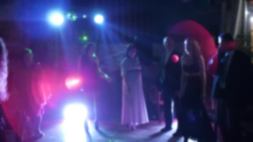 Cheerful girls living it up on the dance floor. friends dancing on the dance floor at the club. holiday, wedding, light, lights, off to the music. camera defocus. | Shutterstock HD Video #23416549