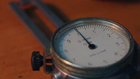 vintage micrometer on table