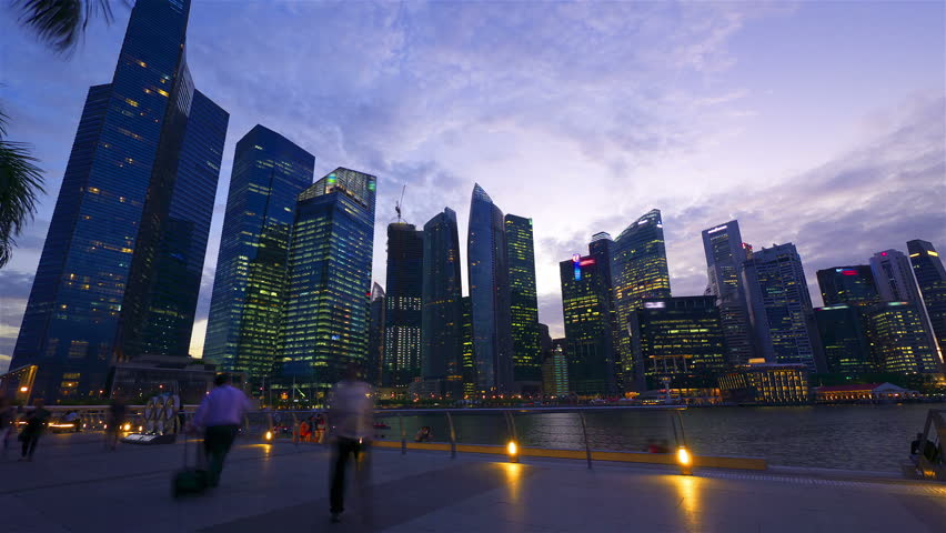 SINGAPORE - MAY 8: (Timelapse in motion view) Sunset at Marina bay quay in the centre of Singapore on May 8, 2012.