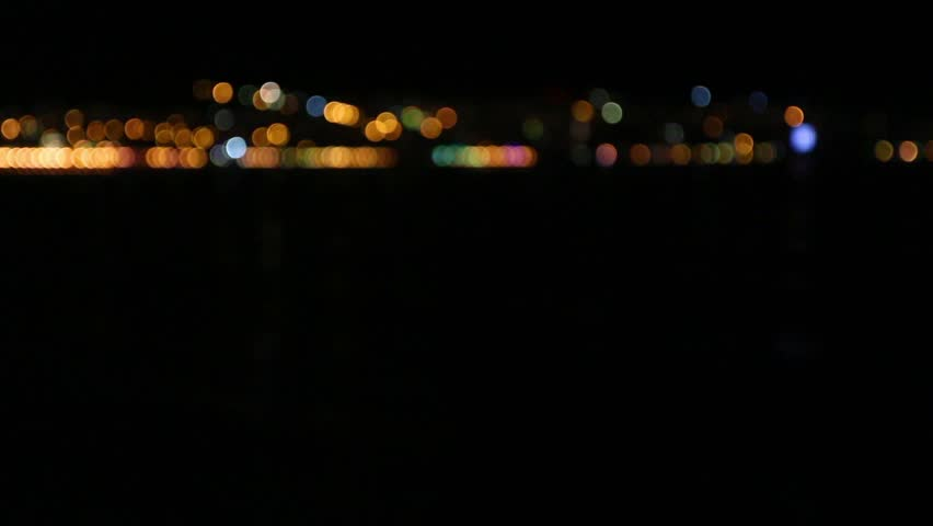 Defocused night city lights in the distance video clip | Shutterstock HD Video #23427229