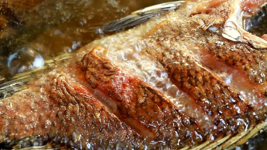 frying fish in pan