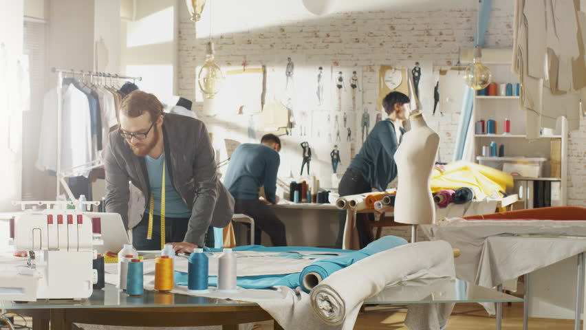 Time-Lapse of a Fashion Designer/ Dressmaker/ Seamstress Working in a Sunny Studio. They Work on a Sewing Machine, Choose Fabrics, Templates, Sketches. | Shutterstock HD Video #23430175
