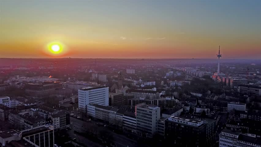 ESSEN / GERMANY - JANUARY 25 2017 : The city skyline under the sunset, aerial