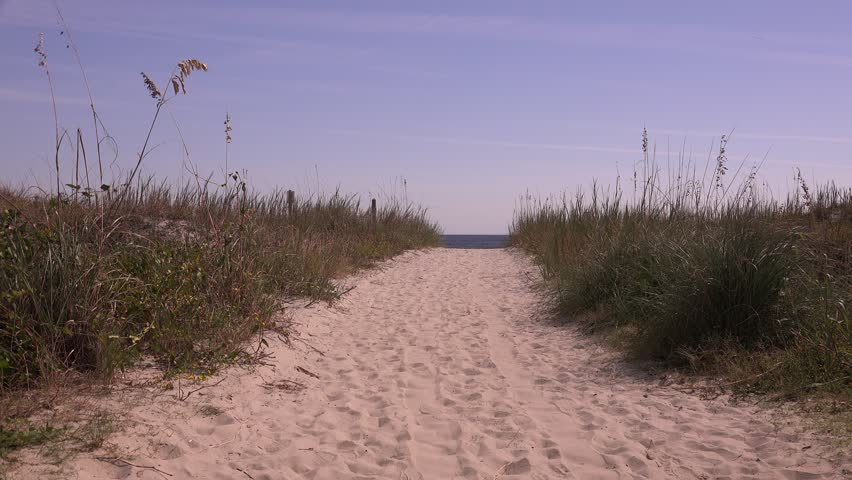 Path through the seagrass on the sand dune to the beach. North Myrtle Beach, South Carolina.