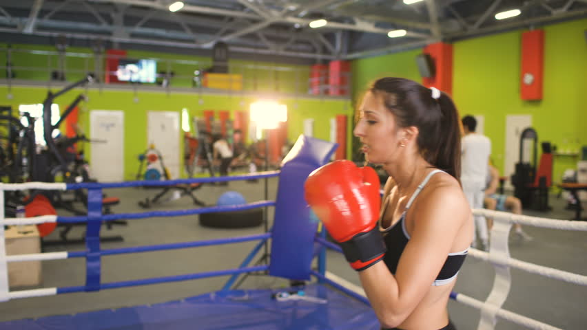 Young Woman Kickboxer Training Pre Match Warm Up In The Boxing Ring With Her