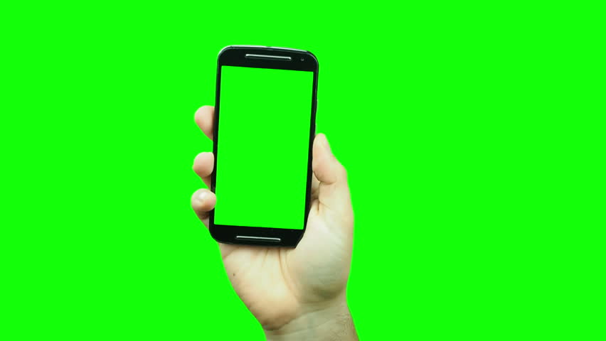 Hand popping up showing blank green screen smartphone on chroma key #23504809