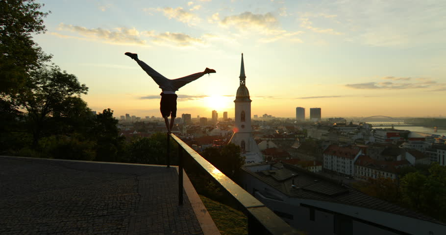 Young Man Doing Handstand on the Rail During Sunrise | Shutterstock HD Video #23511259