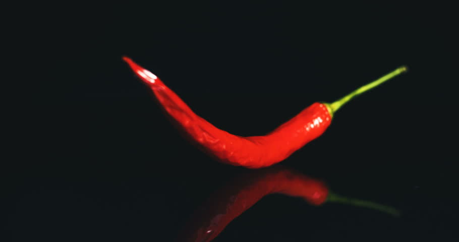 a258f414c9e6 Red Chilli Pepper. Black Background Stock Footage Video (100 ...