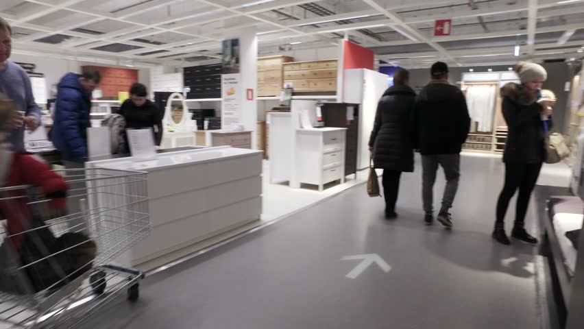 moscow russia january 21 2017 ikea customers in the store choosing furniture and accessories dutch production and trading company the owner of retail
