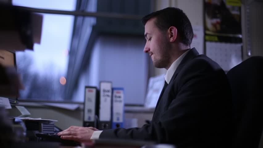Unhappy Employee Working Long Hours   Shutterstock HD Video #23540539