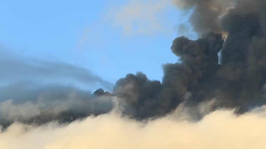 Tungurahua volcano in Ecuador, high presure gases and ash is blown into the sky. | Shutterstock HD Video #2354909