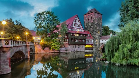 Maxbrucke bridge and Henkerturm tower - part of western medieval fortifications of Nuremberg (static image with animated sky and water)