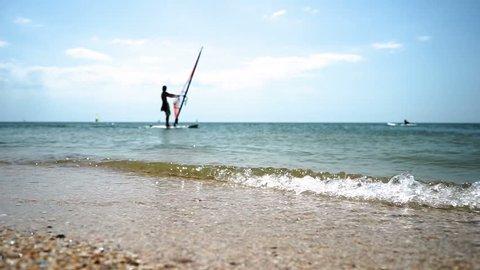 Windsurfer Falls Down from Board Stock Footage Video (100