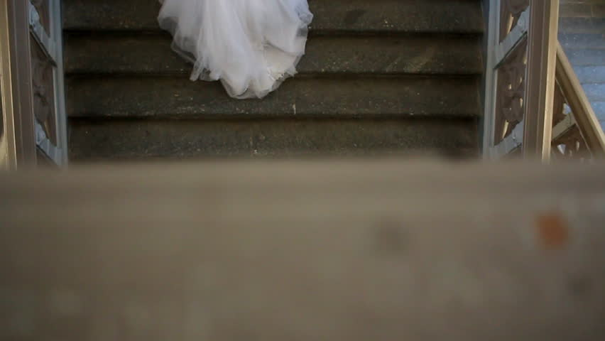 The groom walks to the bride and ascends a staircase.   Shutterstock HD Video #23566699