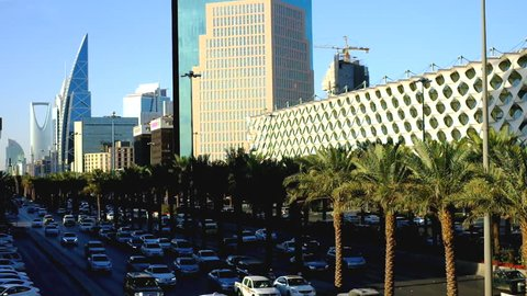 RIYADH, SAUDI ARABIA - JANUARY 25, 2017: Cars during rush hour along King Fahad Highway with buildings such as Kingdom Tower and King Fahd National Library at the background