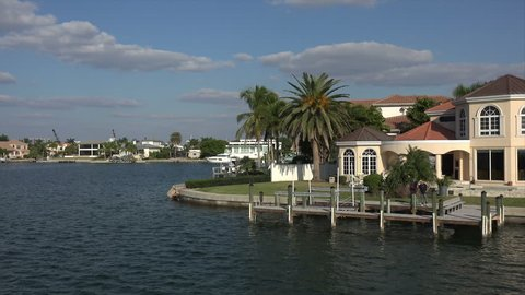 SARASOTA, FLORIDA/USA - NOVEMBER 18, 2016: Tracking clip along luxury waterfront houses, Sarasota Bay. The city limits have expanded because of the real estate rush of the early twentieth century.