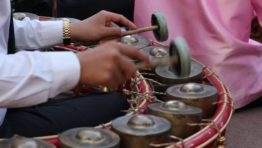 Playing Thai xylophone Traditional gamelan music instrument.