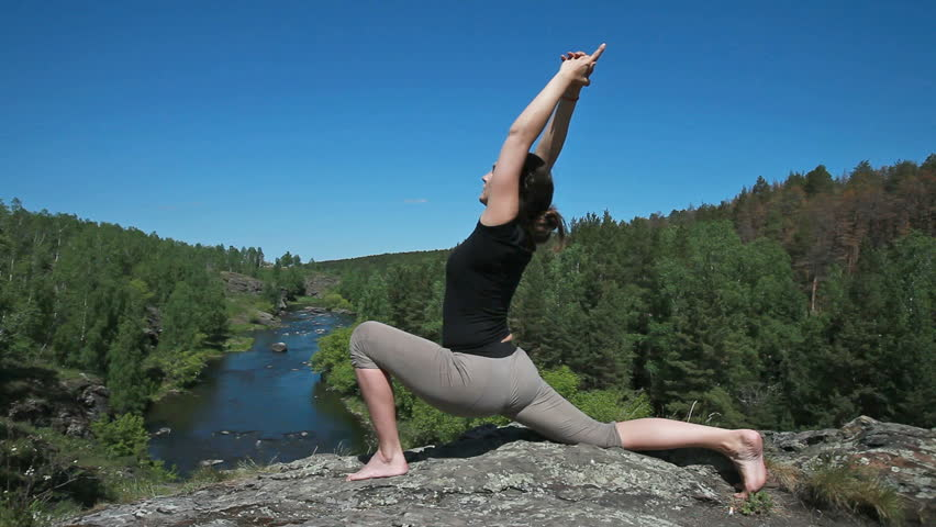 Yoga girl holding balance doing various asanas in the natural environment | Shutterstock HD Video #2365259