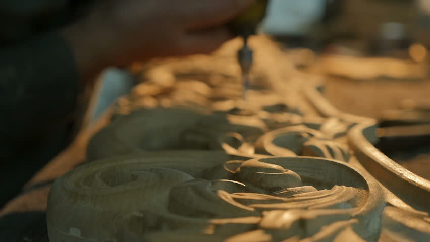 Slow motion man are making wooden pattern for furniture in the work shop