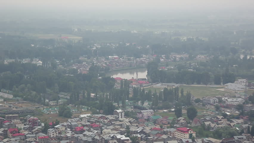 Srinagar in India lies on the banks of the Jhelum River, a tributary of the Indus, and Dal lake, famous for its gardens, waterfronts and houseboats/ View of Srinagar and Dal Lake/ Jammu and Kashmir