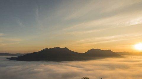 Timelapse of sunshine on the morning mist at Phu Thok, Loei, Thailand.