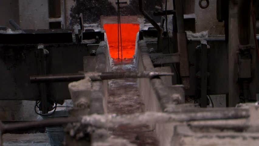 Molten metal flowing liquid aluminium casting at foundry