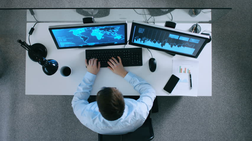 Top View of Information Technology Specialist Working With International Servers and Internet Traffic. It's Early Morning or Late Evening. Shot on RED EPIC-W 8K Helium Cinema Camera. | Shutterstock HD Video #23817979