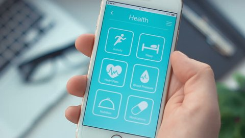 Checking heart rate monitoring on health app on the smartphone