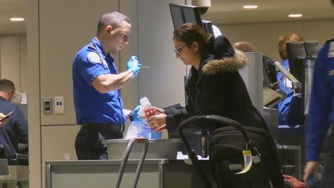 BOSTON, MA - JAN 15: TSA airport security officers screen travelers luggage on January 15, 2017. The TSA employs around 47,000 TSO staff agents who screen people and property in American airports.