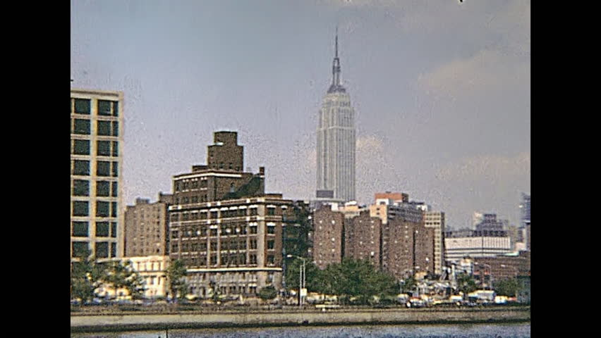 New York, United States of America - circa 1970: ancient Manhattan skyline panorama on seventy with old Empire State Building, from boat tour Circle Line Sightseeing Cruise on East river.