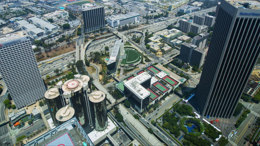 Timelapse overview with tilt up motion of busy traffic in downtown Los Angeles in the daytime | Shutterstock HD Video #23858416