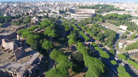 Aerial bird view Italy Rome flying over Domus Severiana moving slowly backwards from Colosseum extension to imperial palaces Palatine Hill in Roma popular tourist attraction in large city center 4k