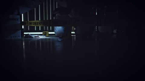 4K Crime Scene Inspector Collecting Fingerprints from Knife