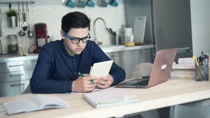 home office multitasking.  office young teenager multitasking doing homework at home  hd stock footage clip throughout home office multitasking i