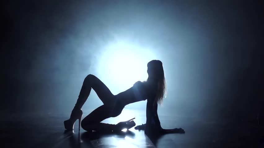 Slow motion. Silhouette pj model grl dancer in smoky studio