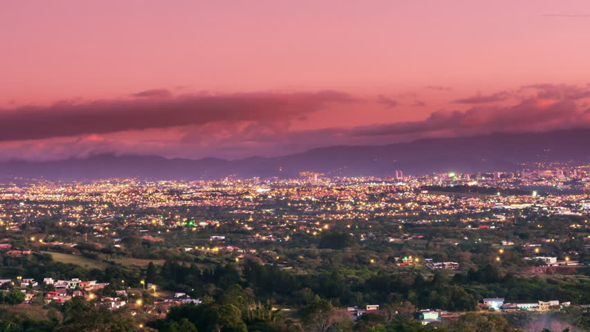 time lapse of san jose' city cityscape from day to night costa rica