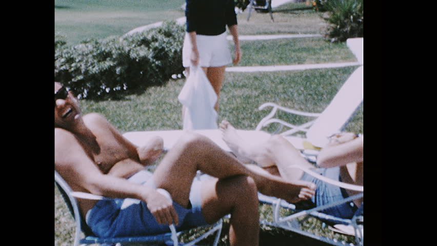 UNITED STATES 1960s: John Erlichman with Henry Kissinger, Dwight Chapin and woman / Erlichman, Kissinger and Chapin relaxing, woman enters building / Chapin plays with camera,
