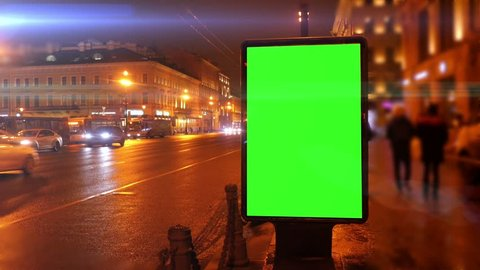 A Billboard with a Green Screen on a Streets