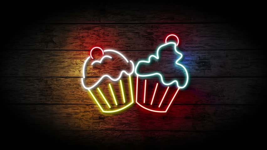 Neon Cupcakes sign turning on and blinking on grunge wooden wall with copy space, food and drinks sign loop, fast food and health care concept. bakery neon sign full hd and 4k.
