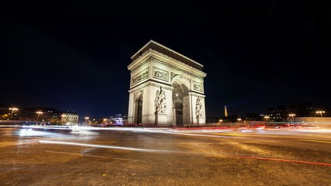 A timelapse at Arc de Triomph in Paris by night. This historical monument overlooks the avenue des champs élysées in the heart of French capital. The photos were taken in long exposure.
