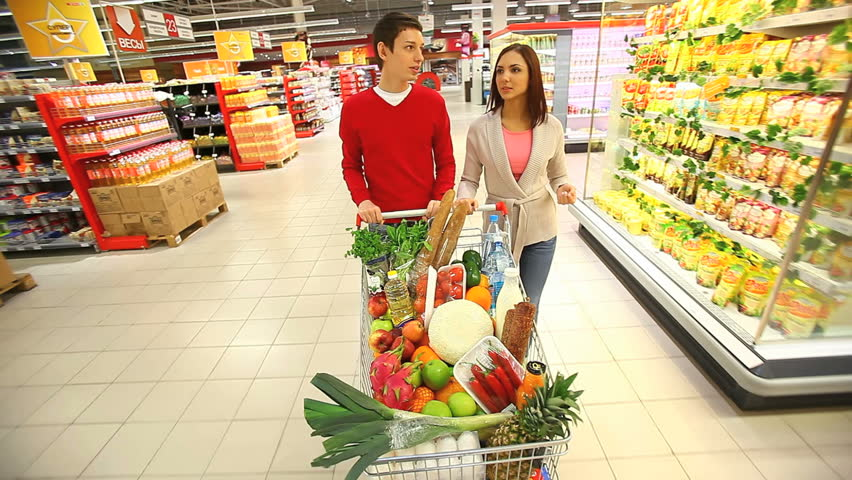 Young Couple Pushing Shopping Cart Stock Footage Video 100 Royalty Free 2395439 Shutterstock