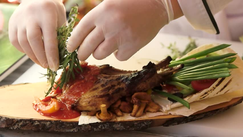 Steak and vegetables on board. Hands of chef and herbs. Master the art of cooking. | Shutterstock HD Video #23954749